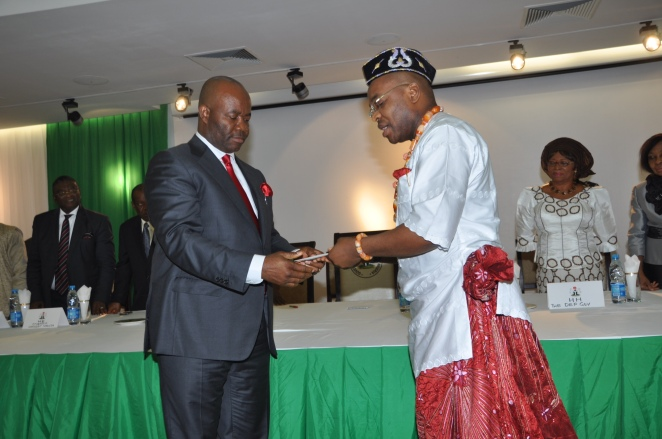 Gov Akpabio congratulating the new Secretary to Akwa Ibom State Goverment, Mr. Udom Gabriel Emmanuel, after the swearing-in formalities in Uyo